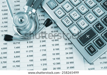 Stethoscope and calculator on document with digits - stock photo