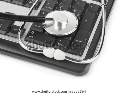 Stethoscope and computer keyboard isolated on white background