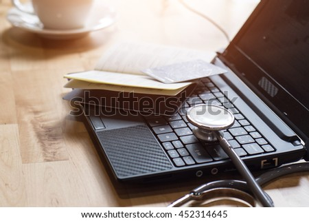 Stethoscope and credit card symbol for financial health - stock photo