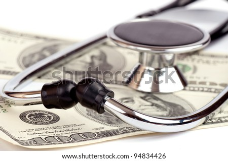 Stethoscope and Dollars - stock photo