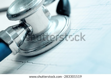 Stethoscope and ECG as a concept of risk for heart disease - stock photo