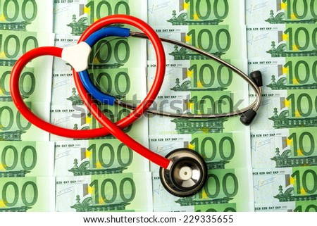 stethoscope and euro banknotes. symbol photo for costs in health care and health insurance for medical and - stock photo