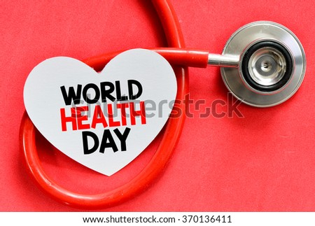 Stethoscope and heart symbol with inscription World Health Day on red background - stock photo