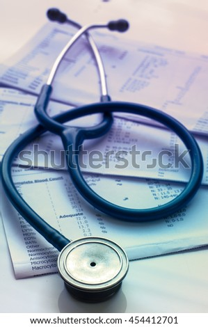 stethoscope and laboratory result, Medical insurance check up, concept.