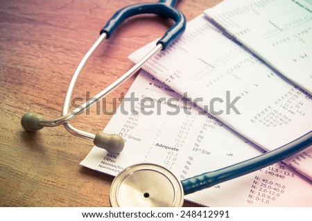 stethoscope and laboratory result, Medical insurance concept. - stock photo