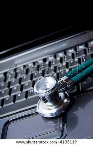 Stethoscope and laptop isolated on white background - stock photo