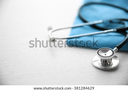 Stethoscope and medical equipment on a light background - stock photo