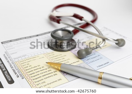 Stethoscope and Medical form.
