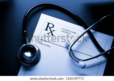 Stethoscope and patient list on black - stock photo