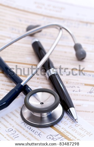 Stethoscope and pen on top of hand-written doctor's notes and forms.