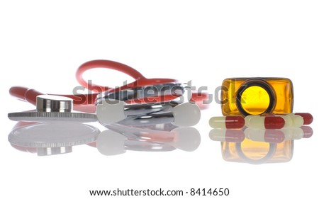 stethoscope and phial with pills on white, isolated, with reflection