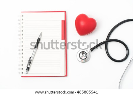 Stethoscope and red heart lying on cardiogram. Healthcare, cardiology and mediacal concept