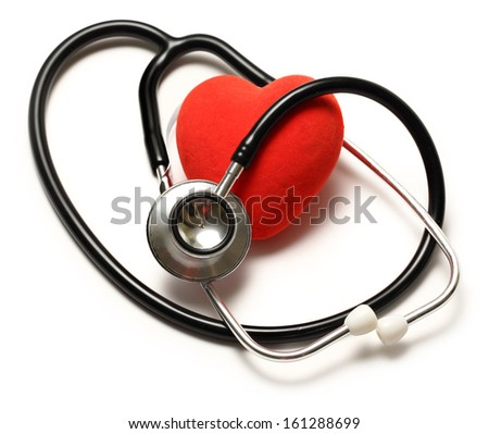 Stethoscope and red heart on white - stock photo