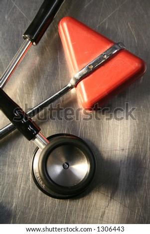stethoscope and reflex hammer - stock photo