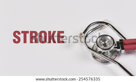 Stethoscope and Stroke note on White Background - stock photo