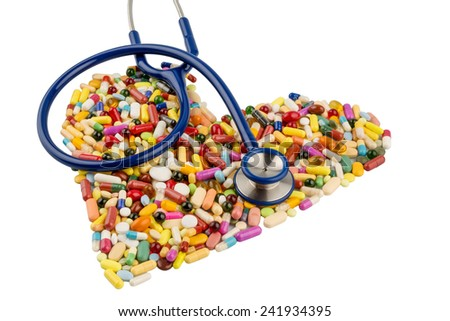 stethoscope and tablets in heart-shaped arrangement, symbolic photo for heart disease, diagnosis and medication