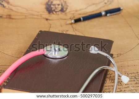 Stethoscope and textbook concept for medical