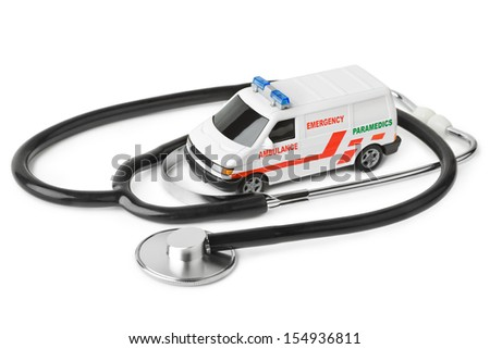 Stethoscope and toy ambulance car isolated on white background - stock photo