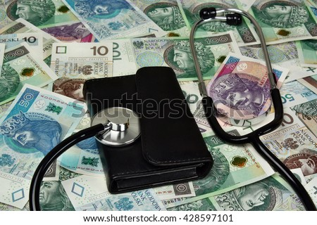 Stethoscope and wallet on polish money background - medical concept