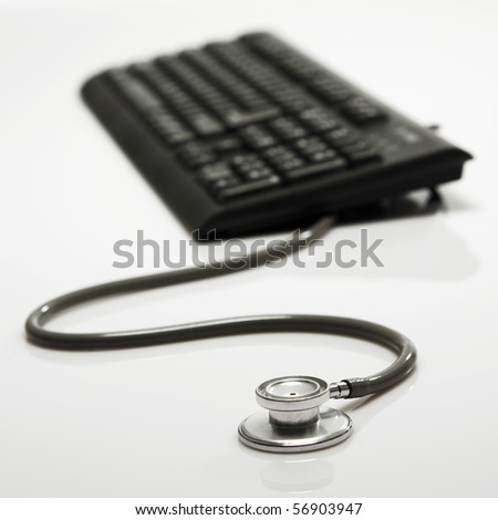stethoscope as a mouse with key board - stock photo