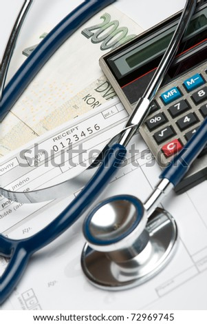 "Stethoscope, blank prescription, calculator and money (Czech koruna): health financing and corrupt practices concept. Selective focus on prescription and word ""receipt"". - stock photo"