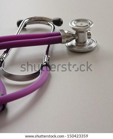 Stethoscope closeup on a white background - stock photo
