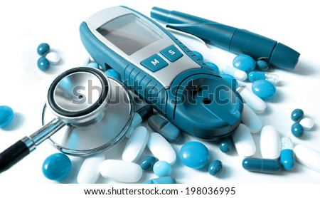 stethoscope,device for measuring blood sugar level and pills     - stock photo