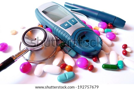 stethoscope,device for measuring blood sugar level and pills isolated on white background - stock photo