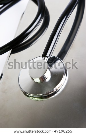 stethoscope in close range on  metal surface
