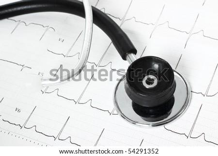 Stethoscope isolated on the cardiogram - stock photo