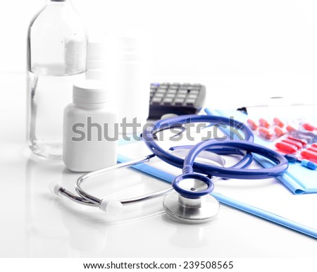 Stethoscope isolated on white - stock photo
