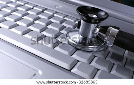 stethoscope laptop - stock photo
