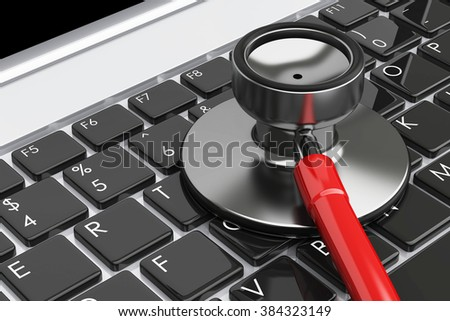 Stethoscope lying on laptop keyboard. A computer repairing and antivirus concept
