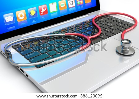 Stethoscope lying on laptop keyboard. A computer repairing, antivirus and medical concept