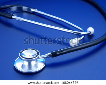 Stethoscope on a blue background.