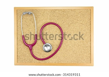 Stethoscope on a cork board, Medical equipment. Examining equipment. - stock photo