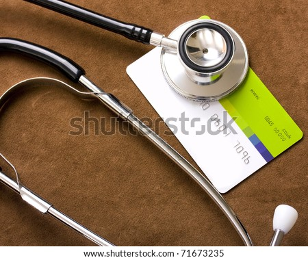 Stethoscope on a credit card - stock photo