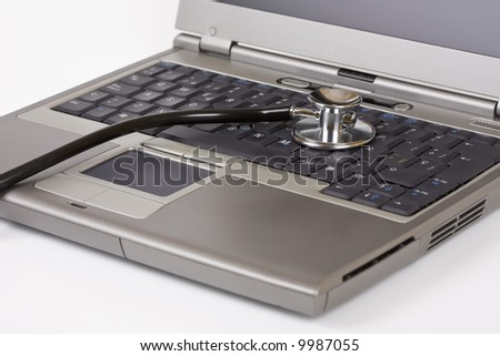 Stethoscope on a laptop - Tech support concept - stock photo