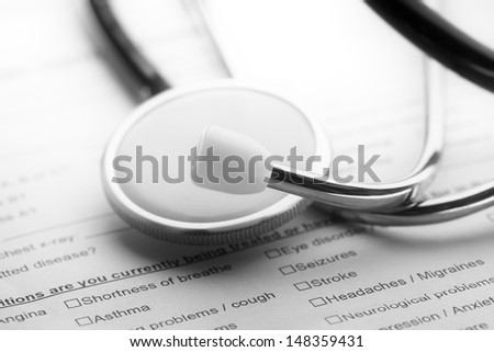 Stethoscope on a medical form. Healthcare concept. - stock photo