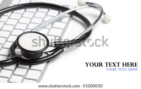 Stethoscope on a modern keyboard, isolated on white with space for text - stock photo