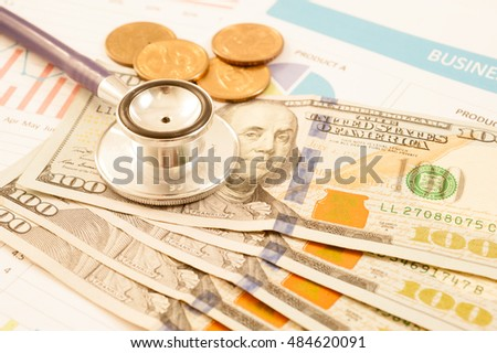 Stethoscope on a pile of money, depicting the health care industry concept