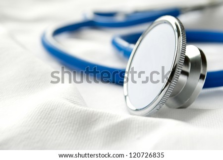 Stethoscope on a white cloth - stock photo