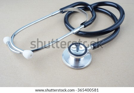 Stethoscope on brown background - health concept. Medical conceptual