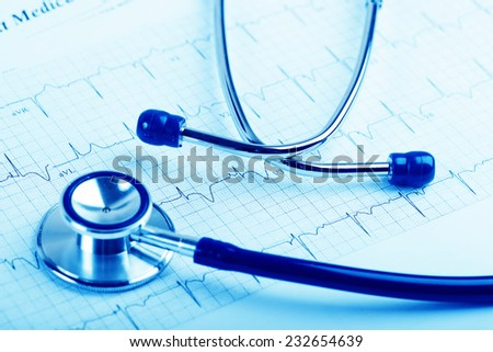 Stethoscope on cardiogram concept for heart care  - stock photo
