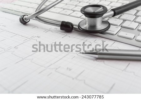 Stethoscope on cardiogram concept for heart care on the desk. - stock photo