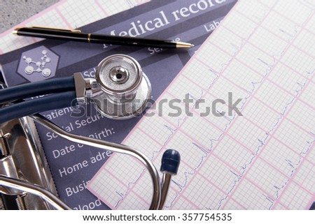 Stethoscope on cardiogram  sheet, closeup - stock photo