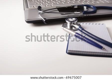 Stethoscope on computer keyboard - stock photo