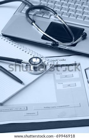 stethoscope on desk - stock photo