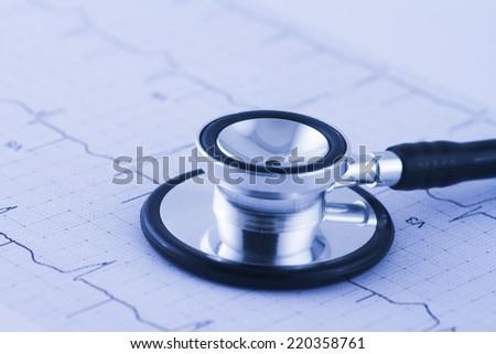 Stethoscope on ECG trace - stock photo