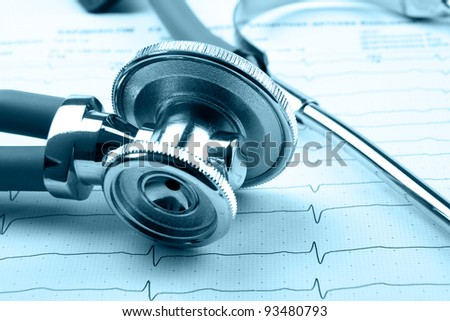 Stethoscope on electrocardiogram - stock photo